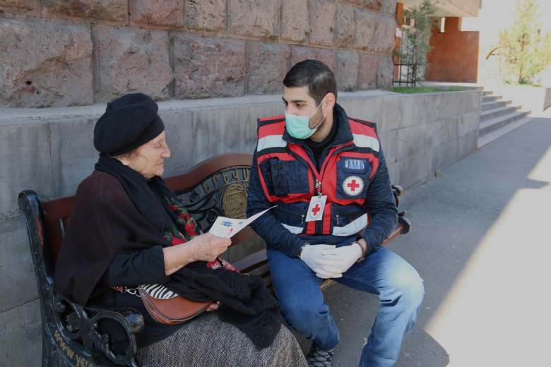 Volunteers distribute informative materials about Coronavirus in public places